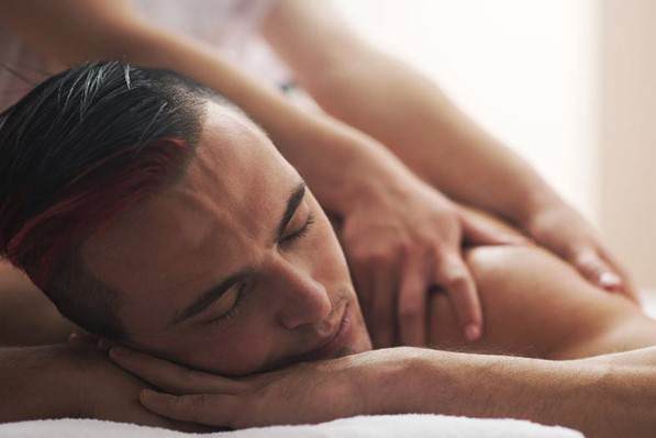 Man has a relaxing massage in spa and wellness salon